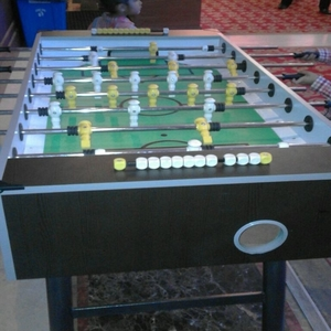 Foosball table game for family day